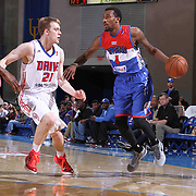 Delaware 87ers Guard Jordan McRae (4) drives drives past Grand Rapids Drive Guard Nate Wolters (21) on defense in the first half of a NBA D-league regular season basketball game between the Delaware 87ers and the Grand Rapids Drive (Detroit Pistons) Saturday, Apr. 04, 2015 at The Bob Carpenter Sports Convocation Center in Newark, DEL.