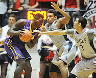 "LSU's Johnny O'Bryant III (2) is defended by Mississippi's Anthony Perez (13) and Mississippi's Sebastian Saiz (11) at the C.M. ""Tad"" Smith Coliseum in Oxford, Miss. on Wednesday, January 15, 2013. Mississippi won 88-74 in overtime. (AP Photo/Oxford Eagle, Bruce Newman)"