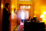A secretary answers the phone during a cabinet meeting with Governor John Kasich in the Statehouse in Columbus, Ohio on Friday, February 25, 2011. Kasich is a advocate for Senate Bill 5, which would eliminate collective bargaining rights for state workers. Governor Kasich claims this a necessary reaction to the state's current budget crisis.