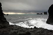 Waves crash against the floor at Dyrhólaey, near Vik, Southern Iceland