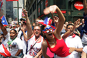 13 June 2010-New York, NY- Crowd Participants at the 2010 Puerto Rican Day Parade held along Fifth Ave from West 44th to West 79th Streets. Crowds estimated up to 2 million enjoyed the music, people and float that lined the Parade route.