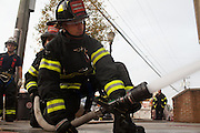 Probationary Fire fighters and military veterans Andres Godoy and Victor Ramos work together at the 16th Street Fire House of the North Hudson Regional Fire and Rescue in Union City, NJ on November 07, 2013. Many vets say after the military they're still looking for a career with a sense of public service. Some vets have found that at the North Hudson Regional Fire and Rescue in New Jersey.