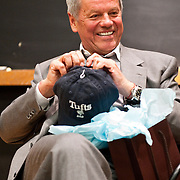 "05/03/2011 - Medford/Somerville, Mass.  Wolfgang Puck holds a ""Tufts Dad"" hat given to him by the Tufts Culinary Society on Tuesday, May 3, 2011.   His son Cameron Lazaroff-Puck, A11, is an undergraduate student at Tufts. (Alonso Nichols/Tufts University)."
