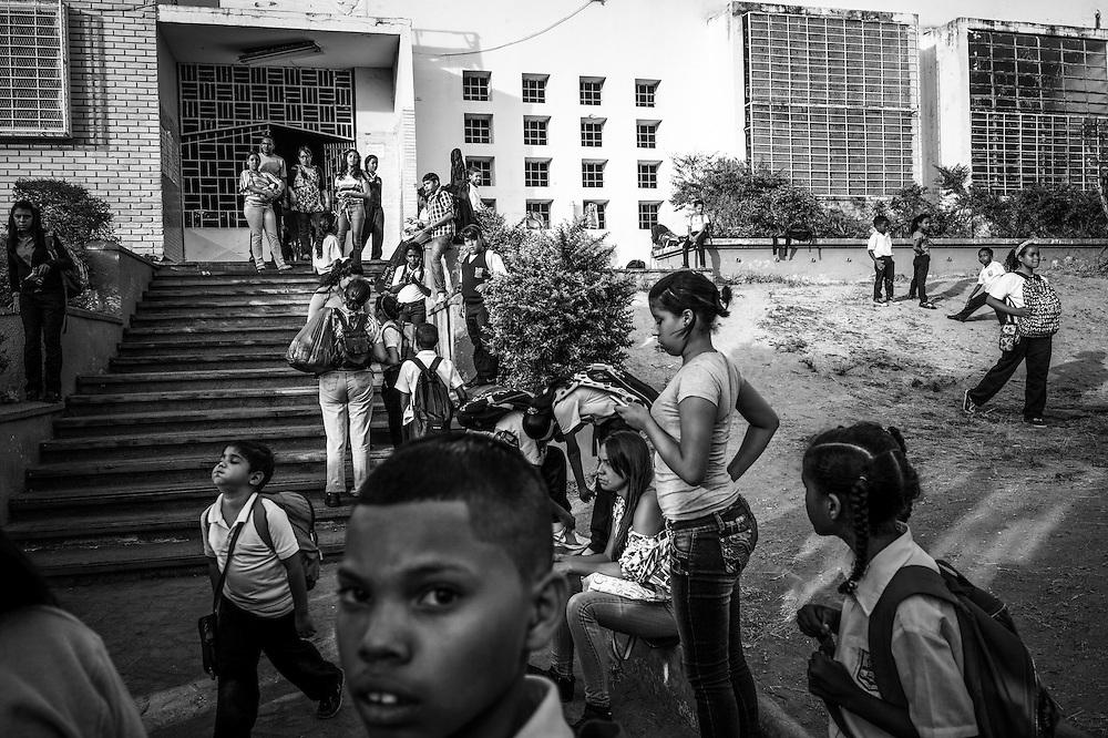 Children play at the entrance to Sarria nucleo, of the El Sistema music program in a dangerous slum in Caracas, Venezuela.