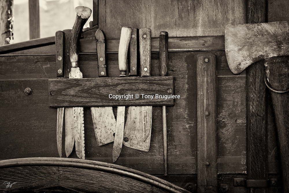 Knives and other cutting utensils hang on the side of a western chuck wagon at Cheyenne,Wyoming.