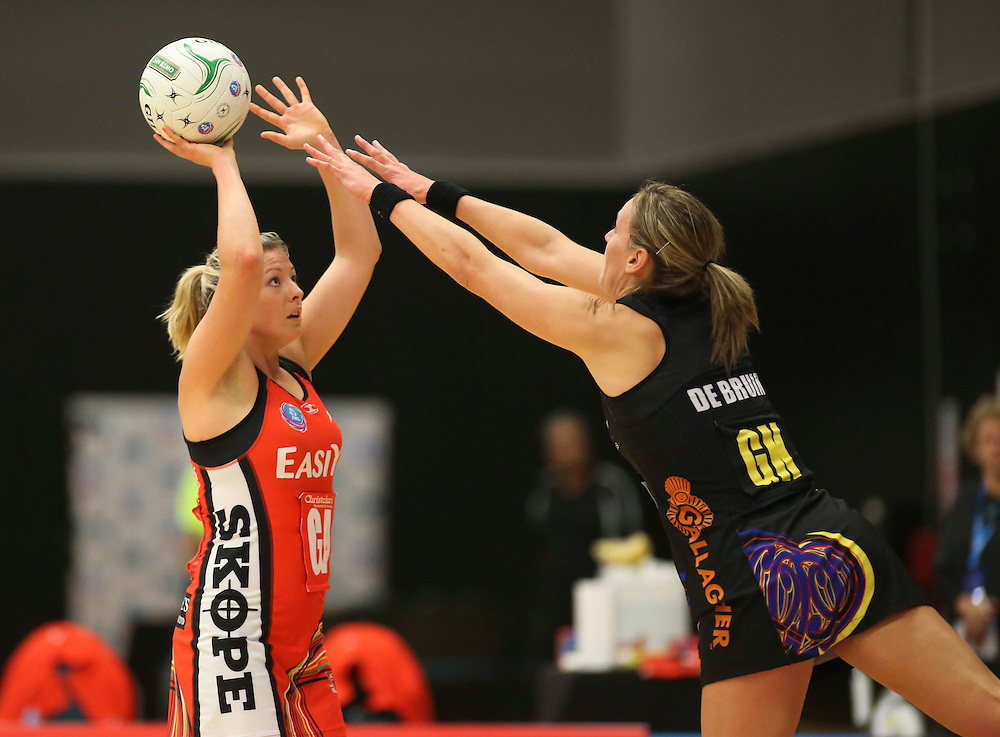 The Tactix Anna Thompson takes a shot under pressure from the Magic's Irene van Dyk  in the teams ANZ Championship Netball match, Energy Events Centre, Rotorua, New Zealand, Monday, 30 April, 2012. Credit:SNPA / John Cowpland