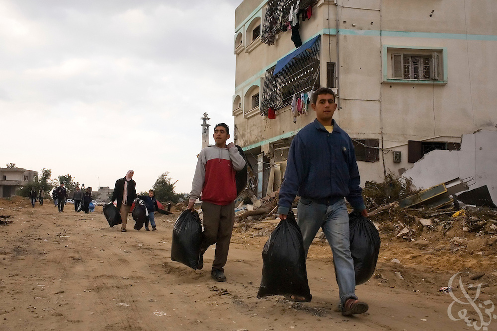 Residents of Beit Lahiya in the northern Gaza Strip return to their homes for the first time since they fled during the 21 day Israeli operation against HAMAS inside Gaza January 19, 2009. Many residents returned to find destroyed or severely damaged homes from the fighting. According to the United Nations and Palestinian officials, more than 4,000 homes were destroyed during the Israeli operation.