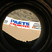 View of the sponsors banners through one of the tunnels at Glen Helen MX Park during the ATVA MX Nationals Round #1.