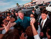 President Bill Clinton visits residents of South Tucson, Arizona, near the Mi Nidito restaurant on South Fourth Avenue in February of 1997.