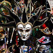 SHOT 3/4/2006 - Carnevale masks for sale in from a street vendor in Venice, Italy. Carnevale in Italy is a huge winter festival celebrated with parades, masquerade balls, entertainment, music, and parties. Children throw confetti at each other. Mischief and pranks are also common during Carnevale, hence the saying A Carnevale Ogni Scherzo Vale, anything goes at carnival. Masks, maschere, are an important part of the carnevale festival and Venice is the best city for traditional carnival masks. Carnival masks are sold year round and can be found in many shops in Venice, ranging from cheap masks to elaborate and expensive masks. Walking through the streets of Venice, it's a pleasure to view the variety of masks on display in shop windows. People also wear elaborate costumes for the festival and there are costume or masquerade balls, both private and public..(MARC PISCOTTY/ © 2006)