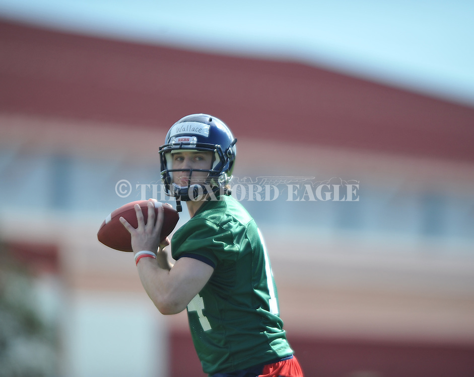 Quarterback Bo Wallace goes through a drill as Mississippi began spring practice in Oxford, Miss. on Friday, March 23, 2012. (AP Photo/Oxford Eagle, Bruce Newman)