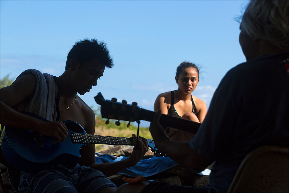 At the Keawanui Fishcamp, Brother Nolan kanikapila with Kai Kahoaliki Fonseca.  Karina Jacany looks on.
