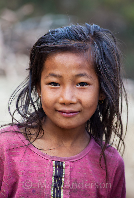 Portrait of a young Nepalese girl smiling, Helambu Region, Nepal