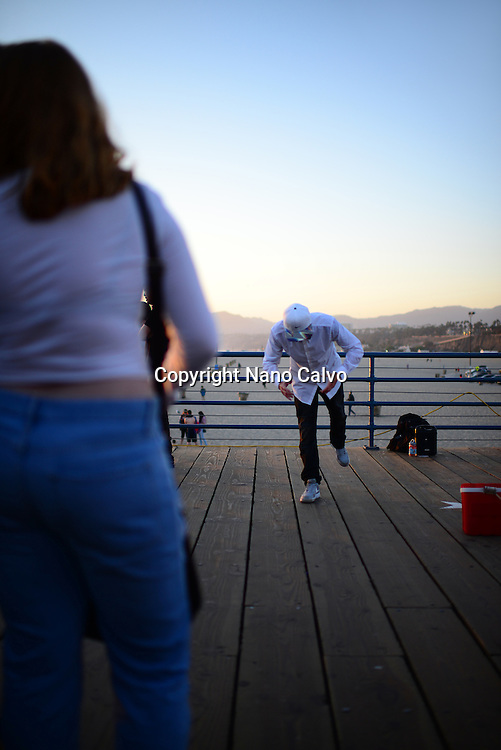 Street popping dancer performing in Santa Monica pier, California.