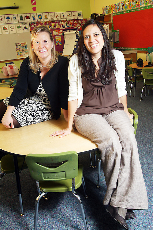 Sarah Beyer and Liza Veliz-Torres teach kindergarten students in adjacent classrooms at Washington Elementary School in Woodburn on Thursday, Dec. 1, 2011. The long-time friends attended the school together.