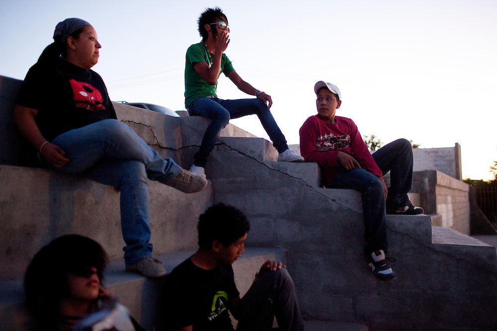 Friends hang out near a church in the Diaz Ordaz colonia, a gang area, in Ciudad Juarez, Chihuahua Mexico on May 7, 2010. ..