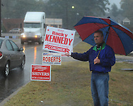 Rocky Kennedy Sr. holds a campaign sign as voters go to the polls in the rain at the National Guard Armory in Oxford, Miss. on Tuesday, November 2, 2010.