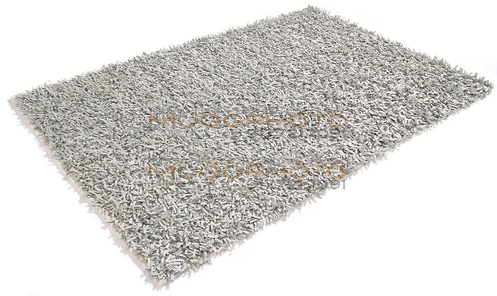 silver ikea rug on a white background | muggphoto