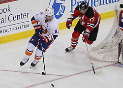 Apr 3; Newark, NJ, USA; New York Islanders defenseman Mark Streit (2) skates with the puck while being chased by New Jersey Devils left wing Ilya Kovalchuk (17) during the third period at the Prudential Center.  The Devils defeated the Islanders 3-1.