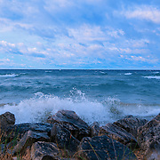 &quot;Morning Waves a Crashing&quot;<br /> <br /> Beautiful strong waves crash against the rocky shores of Lake Michigan in the Upper Peninsula!