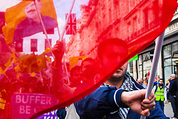London, October 19th 2014. Hundreds of London's Kurdish community march throgh the capital in protest against ISIS and the Turkish government who they accuse, by not getting involved in military action against ISIS, of using the Jihadists to wipe out Kurds who have long been campaigning for an independent Kurdistan. PICTURED: A flag bearer marches along Regent Street.
