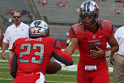 Sept 8, 2012; Piscataway, NJ, USA; Rutgers Scarlet Knights quarterback Gary Nova (15) hands off to Rutgers Scarlet Knights running back Jawan Jamison (23) during the pre-game at High Point Solutions Stadium.