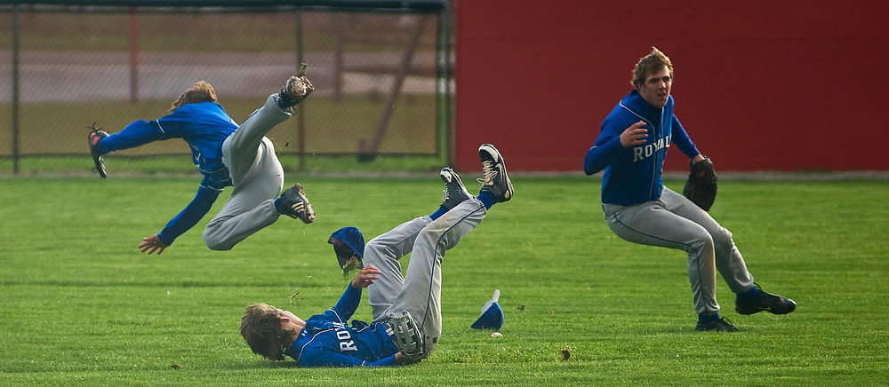 Wynford shortstop Kevin Kruse (left) takes a tumble over Kevin Ransom as Jon Lower avoids a pile up in the outfield during baseball action against Bucyrus on Wednesday.
