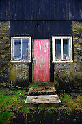 House entrance resembles a face in Mykines village, Mykines island, Faroe Islands