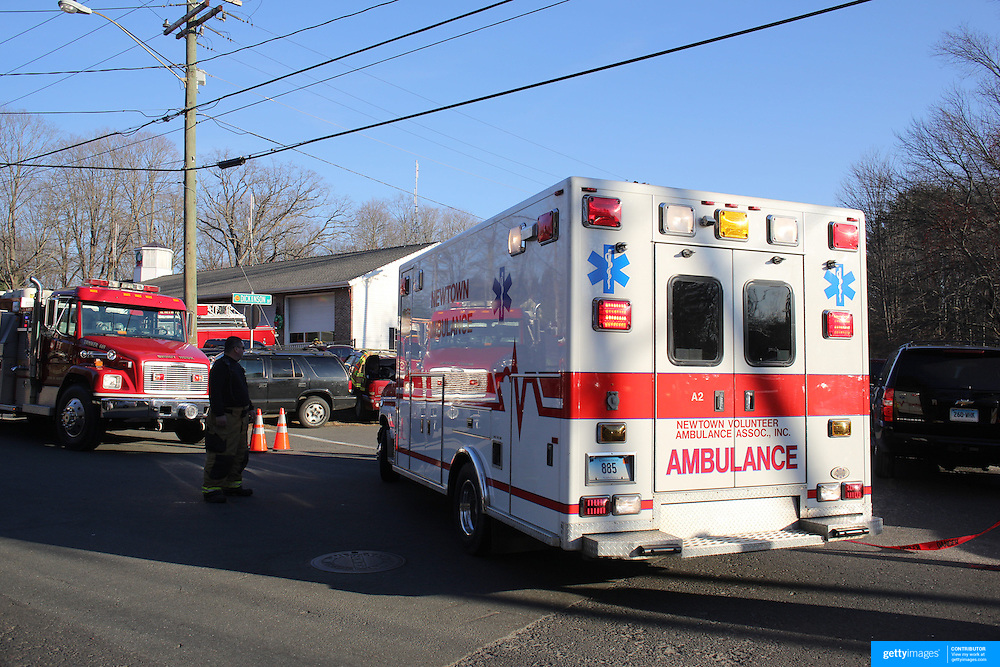 Ambulances at the scene near the fire Station near  Sandy Hook after today's shootings at Sandy Hook Elementary School, Newtown, Connecticut, USA. 14th December 2012. Photo Tim Clayton