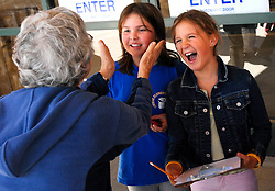 NEWS&GUIDE PHOTO / PRICE CHAMBERS.Shirley Craighead, a board member of the Jackson Hole Food Bank jokes with fourth graders Chelsea Lane, left and Alicia Evans outside Albertson's on Thursday. The kids are part of a catacism class Our Lady of the Mountain Catholic Church. The group raised $899 which will all be donated to the food bank. Some of the children took Albertson's by storm and bought almost $400 dollars worth of groceries.