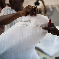 Election commissioners begin counting the votes of the senegalese presidential elections, minutes after the close of the scrutiny at a polling station in Berthe Mauber school in central Dakar..In the early hours, a crowd of hundreds insulted and heckled the president and candidate Abdoulaye Wade during his vote casting at the poll station at a Franco-Arab school in Point E area of Dakar, accusing the head of state of disrespect for the country's constitution when running for a third term in office..Tensions between opposition supporters and security forces have been high in the capital Dakar and other cities around the country since Wade announce his candidature late July. Some violent clashes culminated with the death of 12 people and many injured in the past month alone. ©Sylvain Cherkaoui