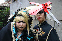 Tokyo Street Fashion - A wide variety of costume play getups can be seen every Sunday in Harajuku - Tokyo's fashion quarter.  Since so many cos-plaers congregate near Tokyo headquarters of Fendi, Hanae Mori and Issey Miyake, some consider this phenomenon to be a reaction to high fashion. Others, such as these girls, appear to be making a statement on fashion itself.