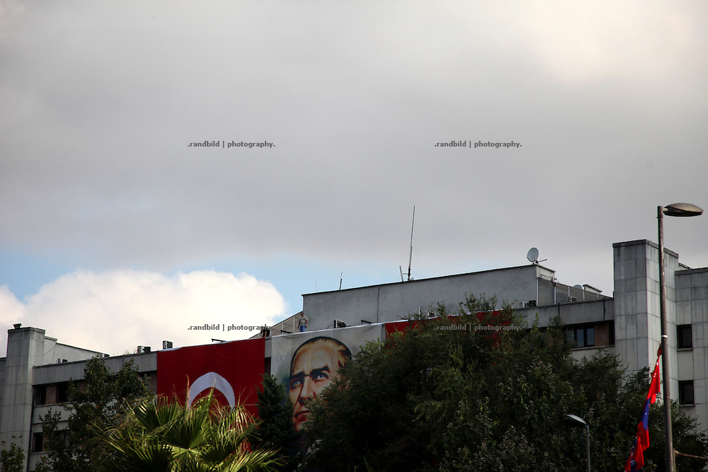 A portrait of former turkish leader Atatürk above a military parade in Istanbul on Zafer Bayrami celebration day (Victory Day).