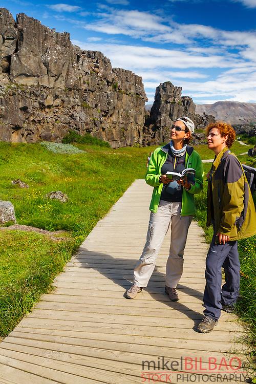 women in Rift Valley. Pingvellir National Park. Golden Circle. Iceland, Europe.