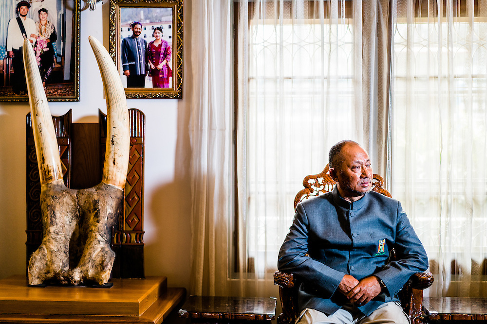 MYITKYINA, MYANMAR - MARCH 13th, 2016:Yup Zau Hkawng, a jade businessman in Kachin State, and member of Peace Talk Creation Group, PCG, in portrait in his home. The group aims to bring reconciliation and peace between the Kachin Independence Army, KIA, and the Burmese Military, who've been in various states of conflict since 1994.