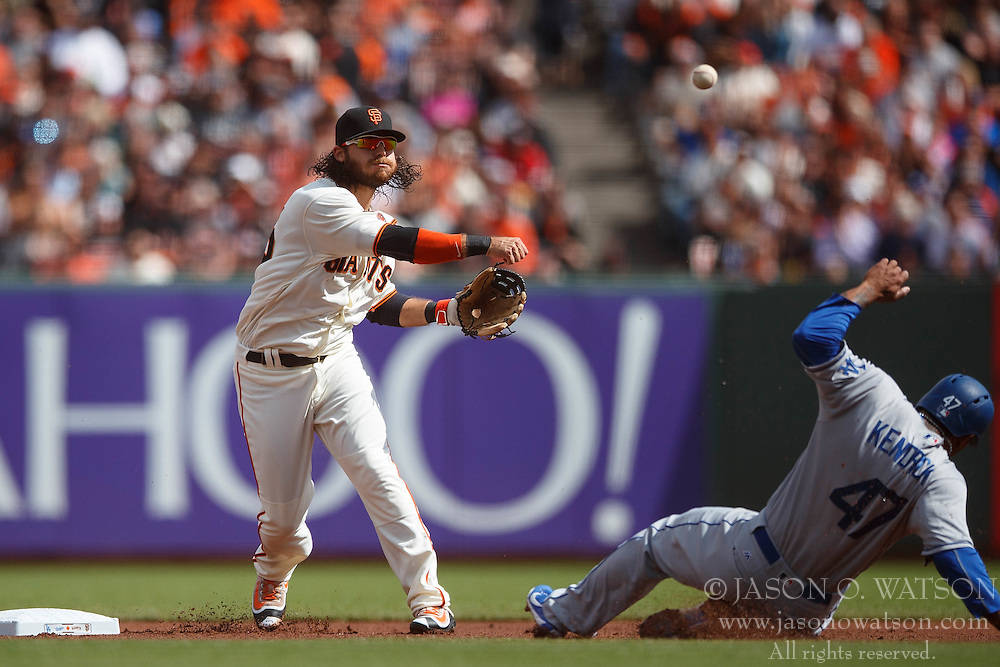 SAN FRANCISCO, CA - OCTOBER 02: Brandon Crawford #35 of the San Francisco Giants completes a double play around Howie Kendrick #47 of the Los Angeles Dodgers during the first inning at AT&T Park on October 2, 2016 in San Francisco, California.  (Photo by Jason O. Watson/Getty Images) *** Local Caption *** Brandon Crawford; Howie Kendrick