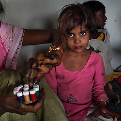 Radha, 15, and Rajni, 5, start preparations for their combined wedding the day before the festivities began, Rajasthan, India, April 26, 2009. Three young sisters Radha, 15, Gora, 13, and Rajni, 5, were married to their young grooms Aleen, Giniaj and Kaushal, who were also siblings, on the Hindu holy day of Akshaya Tritiya, called Akha Teej in north India. The auspicious day is said to bring good luck to couples married then and is widely known in Rajasthan as the day most child marriages occur. Despite legislation forbidding child marriage in India, such as the Child Marriage Restraint Act-1929 and the much more progressive Prohibition of Child Marriage Act of 2006, marrying children off at a very tender age continues to be accepted by large sections of society.