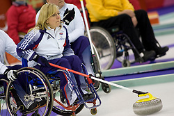 PINEROLO, ITALY - MARCH 15th : Angie Malone of Great Britain prepares to release the stone during the last round-robin match of the curling competition between Great Britain and the USA during Day 5 of the Turin 2006 Winter Paralympic Games on March 15th, 2006 at the Pinerolo Palaghiaccio Stadium in Turin, Italy.