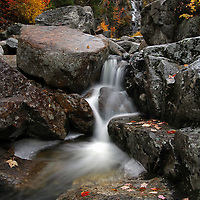 Scenic landscape photos of this stunningly beautiful New England fall foliage and waterfall long exposure photography scenery at Silver Cascade from the Crawford Notch State Park in the White Mountains region of New Hampshire are available as museum quality photography prints, canvas prints, acrylic prints or metal prints. Prints may be framed and matted to the individual liking and decorating needs at:<br /> <br /> http://juergen-roth.pixels.com/featured/silver-cascade-at-crawford-notch-state-park-juergen-roth.html<br /> <br /> This New England waterfall photography features the beauty of Silver Cascade in the Crawford Notch State Park region at October peak fall foliage. The cascading waterfall is located on Route 302 in Carroll County of the White Mountain National Forest region of New Hampshire. The nature photo was taken near Harts Location during New England autumn foliage peak colors in October. This amazing NH waterfall drops an estimated 300 foot. A series of cascades and plunges flowing down the fall lined with picturesque leaf covered rocks make for prominent foreground features in the composition. <br /> <br /> Good light and happy photo making! <br /> <br /> My best, <br /> <br /> Juergen <br /> www.RothGalleries.com <br /> @NatureFineArt <br /> https://www.facebook.com/naturefineart <br /> http://whereintheworldisjuergen.blogspot.com