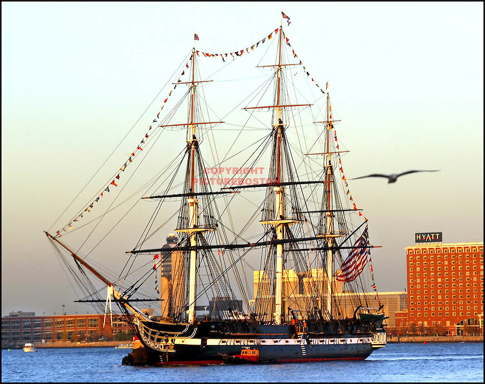 (11/08/2002-Boston, MA) The Old and The new......The U.S.S Constitution moves toward the bow of the U.S.S Preble tonite in anticipation of tommorrows christening ceremonies at World trade ctr's Pier4. Mark Garfinkel photo