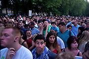 Thousands of people queue to get into Victoria Park to watch the Olympic closing ceremony on a big screen