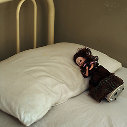 A doll rests on a bed inside the Children's Hospital at the Pakistan Institute of Medical Sciences, P.I.M.S., in Islamabad on Sept. 18, 2007.