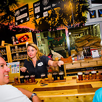 MIAMI, FLORIDA -- July 11, 2015 -- Beer lovers enjoy a large selection of local brews at Wynwood Brewery Company in the Wynwood Art District in Miami, Florida.  (PHOTO / CHIP LITHERLAND)