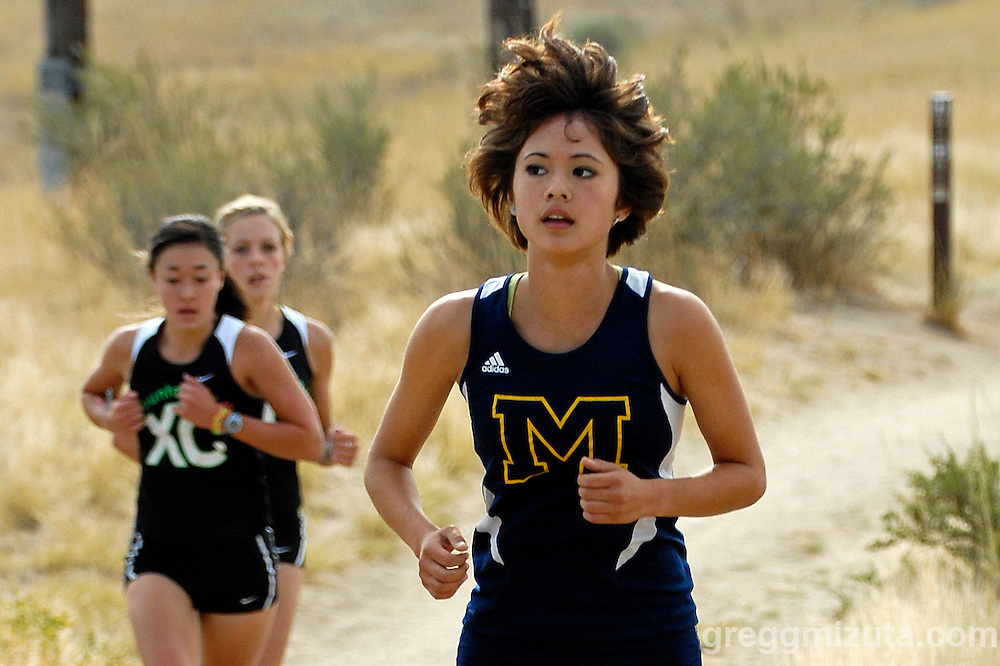 Meridian sophomore Lila Klopfenstein, Mountain View junior Valerie Mitchell and senior Katie Larson near the top of Central Ridge Trail during the Run for the Pie meet in Boise, Idaho on August 28, 2010.