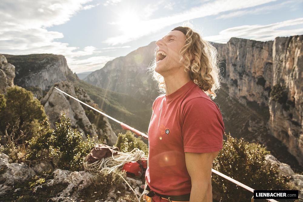 Mich Kemeter celebrates after he finished walking a 113m highline in the Gorges du Verdon.