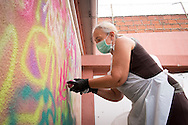 08/09/2015 - Lisbon, Portugal: Maria Manuela Graça, 59, paints a wall during the Lata 65 workshop. Lata 65 was project created by Lara Seixo Rodrigues and is a creative workshop teaching street art to senior citizens. (Eduardo Leal)