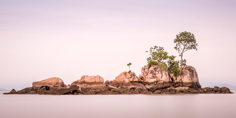 Long exposure image of a small island in Teluk Bahang sometimes referred to as Lover's Isle.