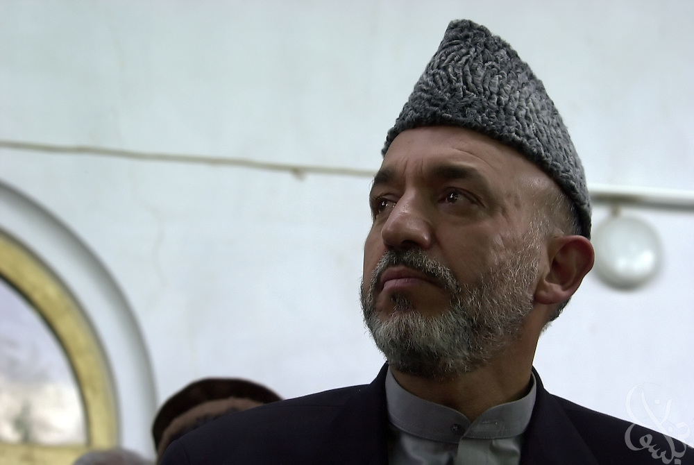 Interim Afghan leader Hamid Karzai meets with tribal elders May 04, 2002 after arriving in the southern Afghan city of Kandahar. The visit by Karzai to the city, his first since assuming power, is significant because of the city's history as a former Taliban stronghold.
