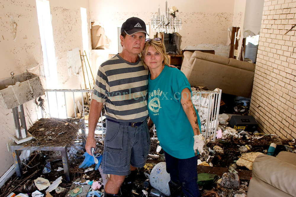 08 Sept 2005.  New Orleans, Louisiana. Hurricane Katrina aftermath. <br /> Venetian Isles in East New Orleans, where the tidal surge washed over the land and devastated homes and property. John and Peggy Lala survey the damage of their mud filled flood ravaged home.<br /> Photo; &copy;Charlie Varley/varleypix.com