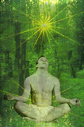Young man meditating, golden light is coming from his solar plexus and is above him. He is surranged by a forest.